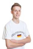 Fan de sports allemande avec les bras croisés Image stock