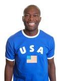 Fan de sports américain riant de l'appareil-photo Photo stock