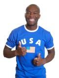 Fan de sports américaine montrant les deux pouces  Photos stock