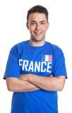 Fan de sports des Frances avec les bras croisés Images libres de droits
