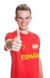 Fan de sports espagnole avec les cheveux blonds montrant le pouce  Photos stock