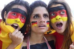 Fan di calcio tedeschi responsabili circa la prestazione del gruppo. Fotografia Stock