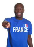 Fan di sport francese che indica alla macchina fotografica Fotografia Stock