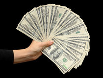 Fan of dollars in a female hand  black background Royalty Free Stock Photo