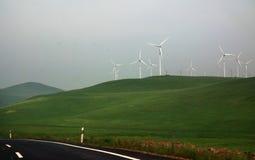 Fan driven generator. On grasslands beside road Stock Photography