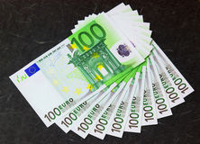 Fan of euro banknotes. 100 euro  banknotes folded in bunch on black bachround Royalty Free Stock Images