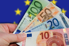 Fan of Euro bills with flag Stock Image