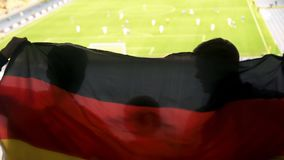 Fan family with child waving German flag, cheering for favorite football team stock photography