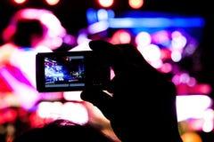 Filming Rock show. Fan filming a rock show Stock Image