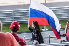 Fan with flag. Sochi, Russia -12 November 2014 : Formula One, Russian Grand Prix,  Sochi autodrom , 16 stage Royalty Free Stock Images