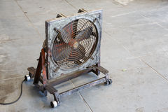 Fan in garage Stock Photo