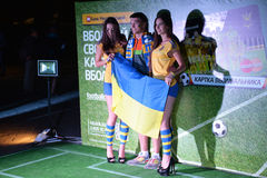 Fan with girls and Ukrainian flag Royalty Free Stock Images