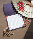 Fan, hair comb and lucky cat. Paper fan with peony, hair comb, lucky cat and letter royalty free stock photos
