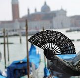 fan in the hand of the woman in Venice in Italy stock photo