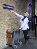 Fan of Harry Potter recreates pushing a trolley towards platform nine and three quarters from the film Royalty Free Stock Photography