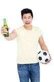 Fan holding a beer bottle and football Royalty Free Stock Photography