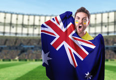Fan holding the flag of Australia in the stadium Royalty Free Stock Image