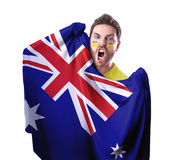 Fan holding the flag of Australia on white background Royalty Free Stock Images