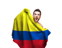 Fan holding the flag of Colombia on white background Stock Images