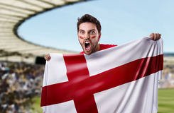 Fan holding the flag of England in the stadium.  Royalty Free Stock Image
