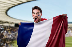 Fan holding the flag of France in the stadium royalty free stock photos