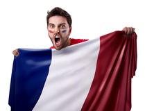 Fan holding the flag of France on white background stock photos