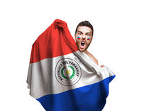 Fan holding the flag of Paraguay on white background Royalty Free Stock Photography