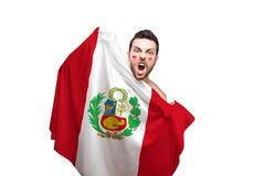 Fan holding the flag of Peru celebrates on white background Stock Photos