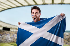 Fan holding the flag of Scotland Royalty Free Stock Images