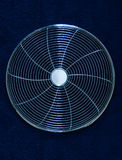 Fan housing. Shiny, circular, chrome plated fan grill / housing or guard to protect the fan blades Stock Images