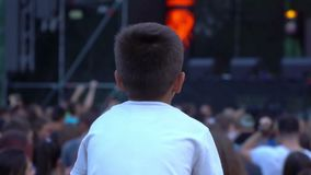Concert kid child festival. Fan kid on father shoulders enjoy listening to concert stock video