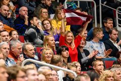 Fan with Latvian flag, during FedCup game stock images