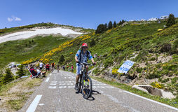 Fan of Le Tour de France. Port de Pailheres,France- July 6, 2013:Youg man funny dressed climbing the difficult road to the Col de Pailheres in Pyrenees Mountain Royalty Free Stock Image