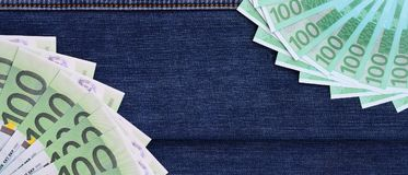 The fan of a lot of euro bills is on a dark denim surface. Backg. Round image stock images