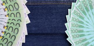 The fan of a lot of euro bills is on a dark denim surface. Backg. Round image stock photos
