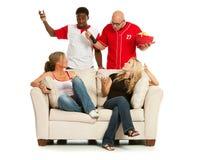 Fan: Mężczyzna Dyskutuje z kobietami Nad TV Zdjęcie Royalty Free