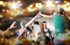 Fan making high five with singer at club concert Royalty Free Stock Images