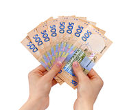 Fan of money. Female hands holding a fan of money royalty free stock image