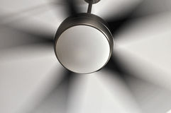 Fan in Motion. The motion of the blades of the ceiling fan Stock Photography