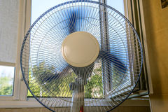 Fan near an open window Stock Photos