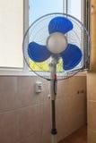 Fan near an open window Royalty Free Stock Image