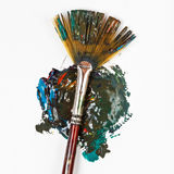 Fan paintbrush blends multicolored watercolors Stock Photos