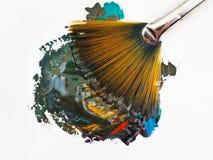 Fan paintbrush miesza stubarwne akwarele zdjęcie royalty free