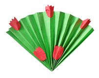 Fan of paper in origami style resembling a bouquet of leaves and tulips stock photos