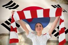 Fan piłki nożnej falowania bielu i czerwieni szalik Obrazy Stock