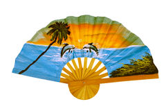 Fan with picture of tropical beach. A fan with a picture of a tropical beach. Opened  fan with pattern of two dolphins, sea, palm trees, sunset, greenery Stock Photography