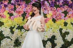 Fan portrait of beautiful bride. Wedding dress. Wedding accessor Royalty Free Stock Image