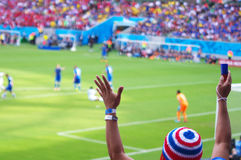 Fan at professional soccer match stock photo