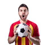 Fan on red and yellow uniform celebrates on white background Royalty Free Stock Photography