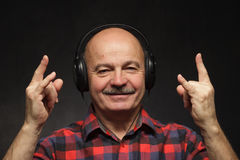 Fan of rock music in the old age. Stock Photography